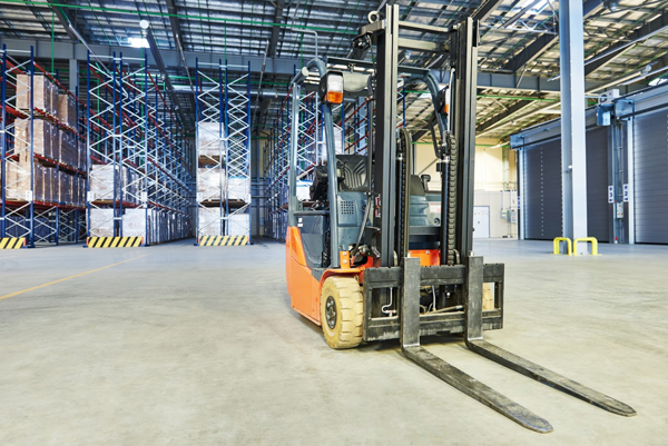 Used forklift equipment indoors at a warehouse