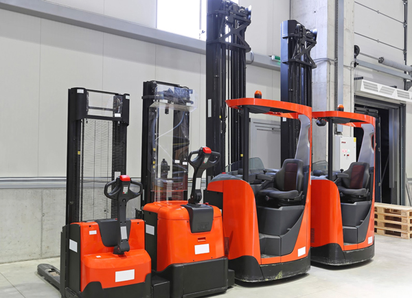 Small used forklifts for sale in a warehouse