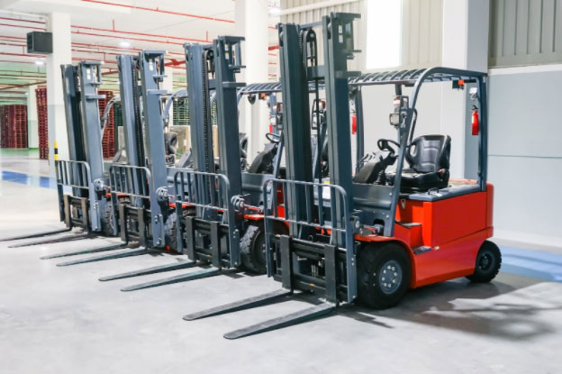 Row of red forklifts for sale